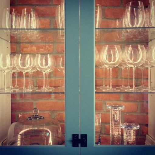 exposed-brick-in-cabinet-mountain-decor-covet-living