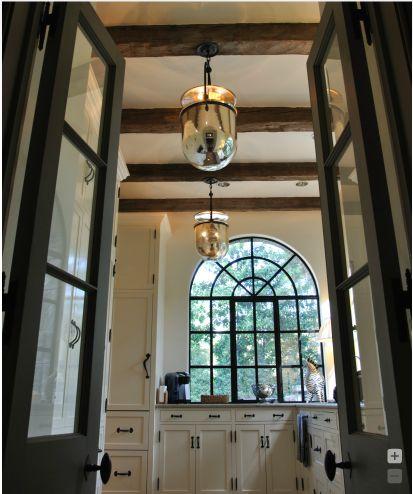curved-black-windows-ue-lanterns-mountain-decor-covet-living